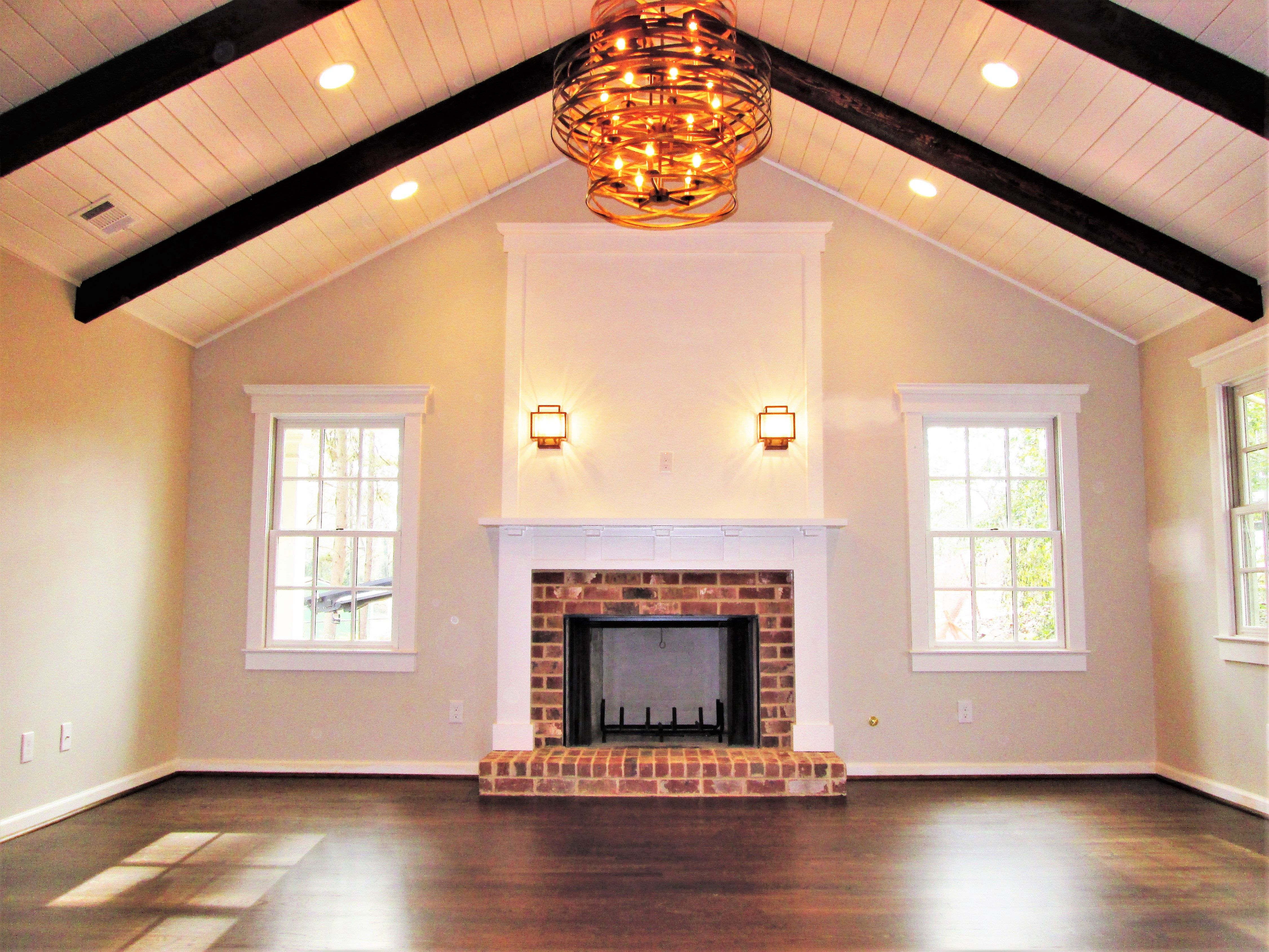 Great Room Addition With Tongue And Groove Vaulted Ceiling And Reclaimed Brick Fireplace By Vaulted Ceiling Living Room Living Room Fans Living Room Remodel