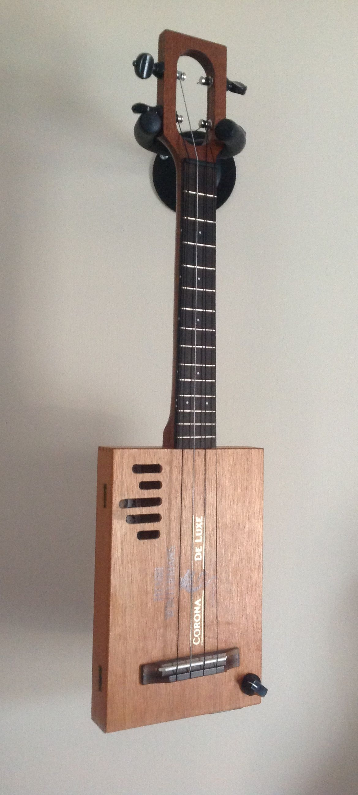My beautiful custom made cigar box ukulele. Made for me by Chickenbone John. And it sounds as good as it looks!!!