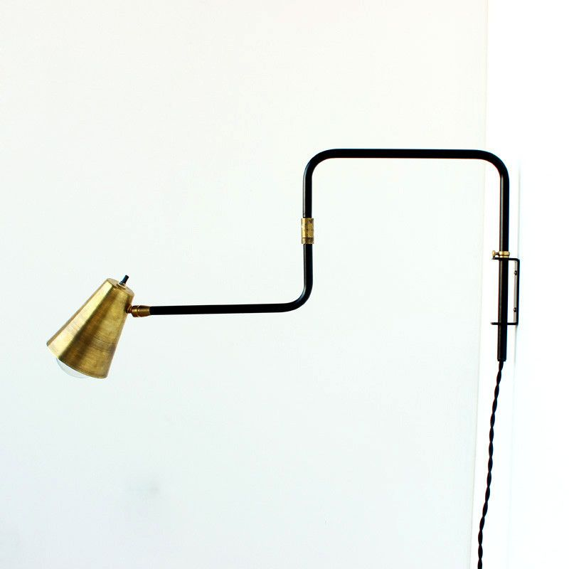 """This is a wall-mount swing lamp made by me. Durable powder-coated finish in matte black. Measures 12"""" tall and extends 24"""" from the wall. Available with an exposed bulb brass socket or brass shade. Shade is 4"""" diameter by 5-1/4"""" deep and swivels on a brass fitting. Wall bracket is powder-coated aluminum. Adjustable height with thumb screw. Cloth twisted cord. Made to order in about 3-4 weeks*. 110v-220v,75watt rating Lampcan be wired with a euro-style plug. If you would like to add this…"""
