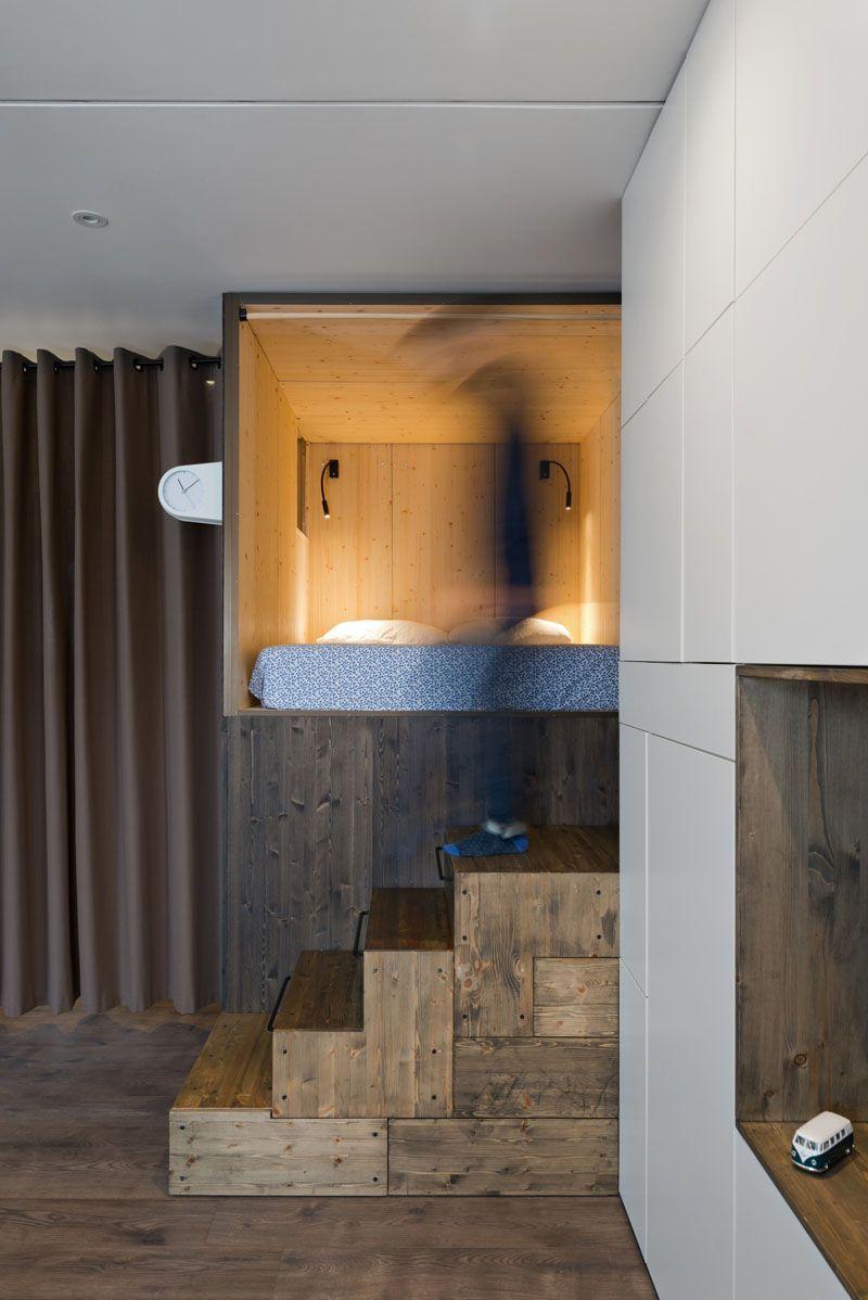 Small apartment design idea raised bedroom allows for storage