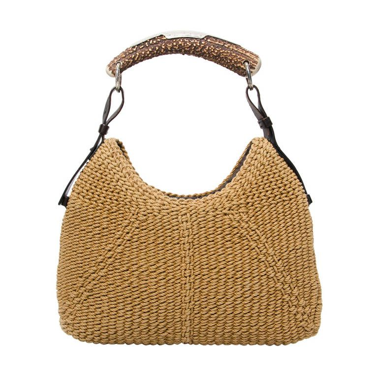 327ac5ce686 Yves Saint Laurent Woven Mombasa Horn Hobo Bag | From a collection of rare  vintage handbags