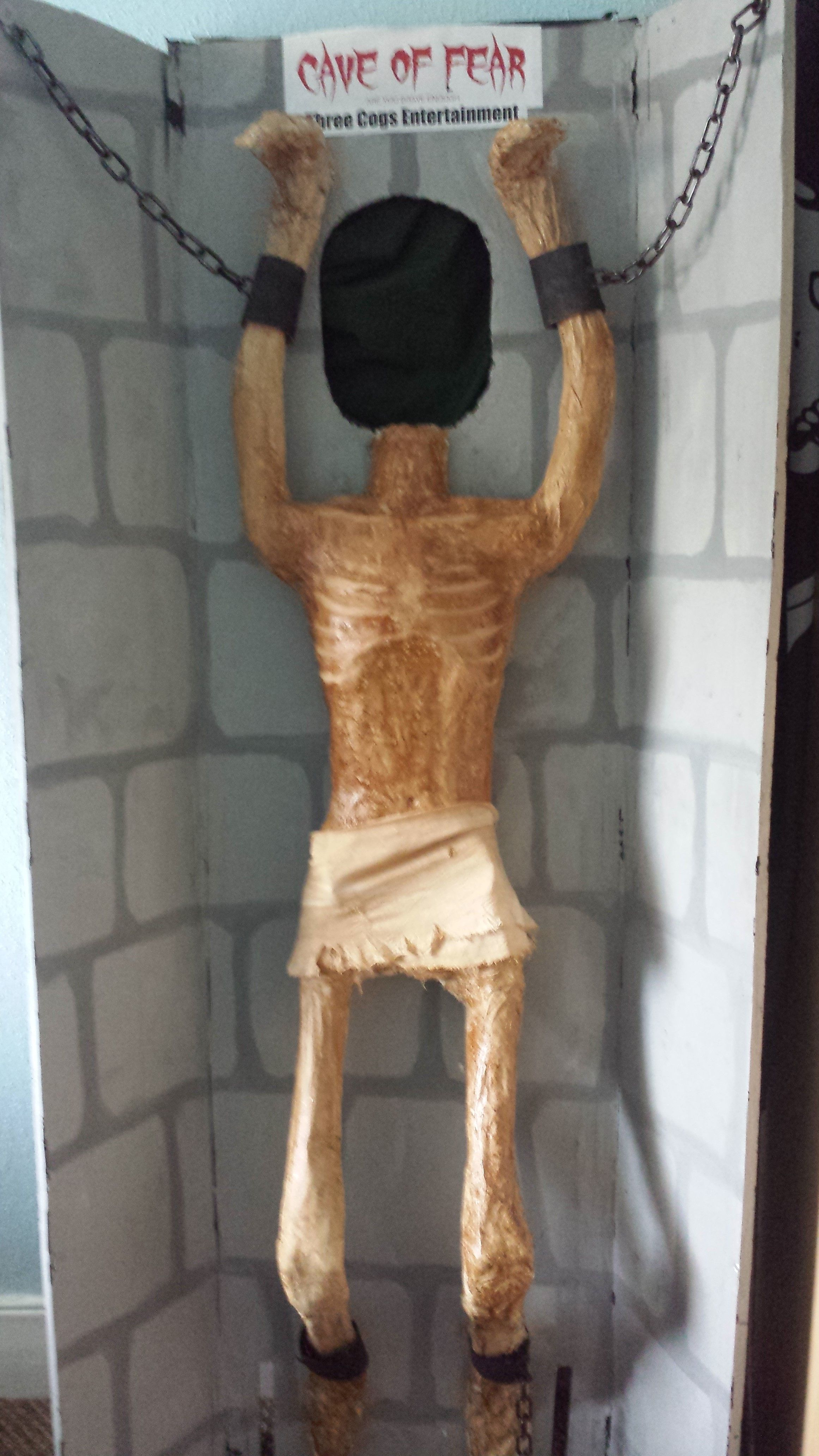 'Hanging Prisoner' photo opportunity.  Recycled wardrobe doors, reinforced at the back, with added feet for stability.  paper mache over a skeleton for the body base,  #3CogsEntertainment