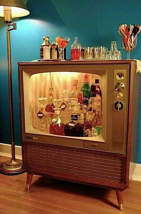 Attractive Liquor Cabinet...Repurposed TV.....Makes A Cute Bar