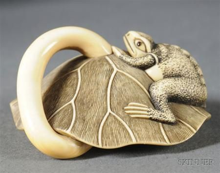Ivory Netsuke, 19th century, a frog with a lotus plant, signed Masatomo, wd. 2 in.