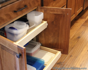 Adjustable #sliding shelves in a new base #cabinet offer a great #storage option for Tupperware containers and lids.   |   VillagHomeStores.com