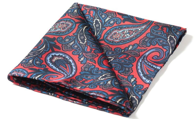 Printed Silk Pocket SquareCandy Apple Red with Navy, Powder Blue & Violet Blue Paisley Pattern ~ With Hand Rolled Edges ~Made From 16oz 'Extra Soft' Silk Twill 100% Pure Silk • Dry Clean Only Printed and Handcrafted in England Dimensions: 30cm...