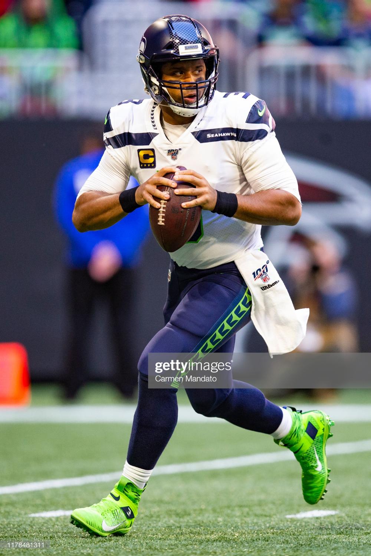 Russell Wilson Of The Seattle Seahawks Looks To Pass During The First Seahawks Seattle Seahawks Wilson Seahawks