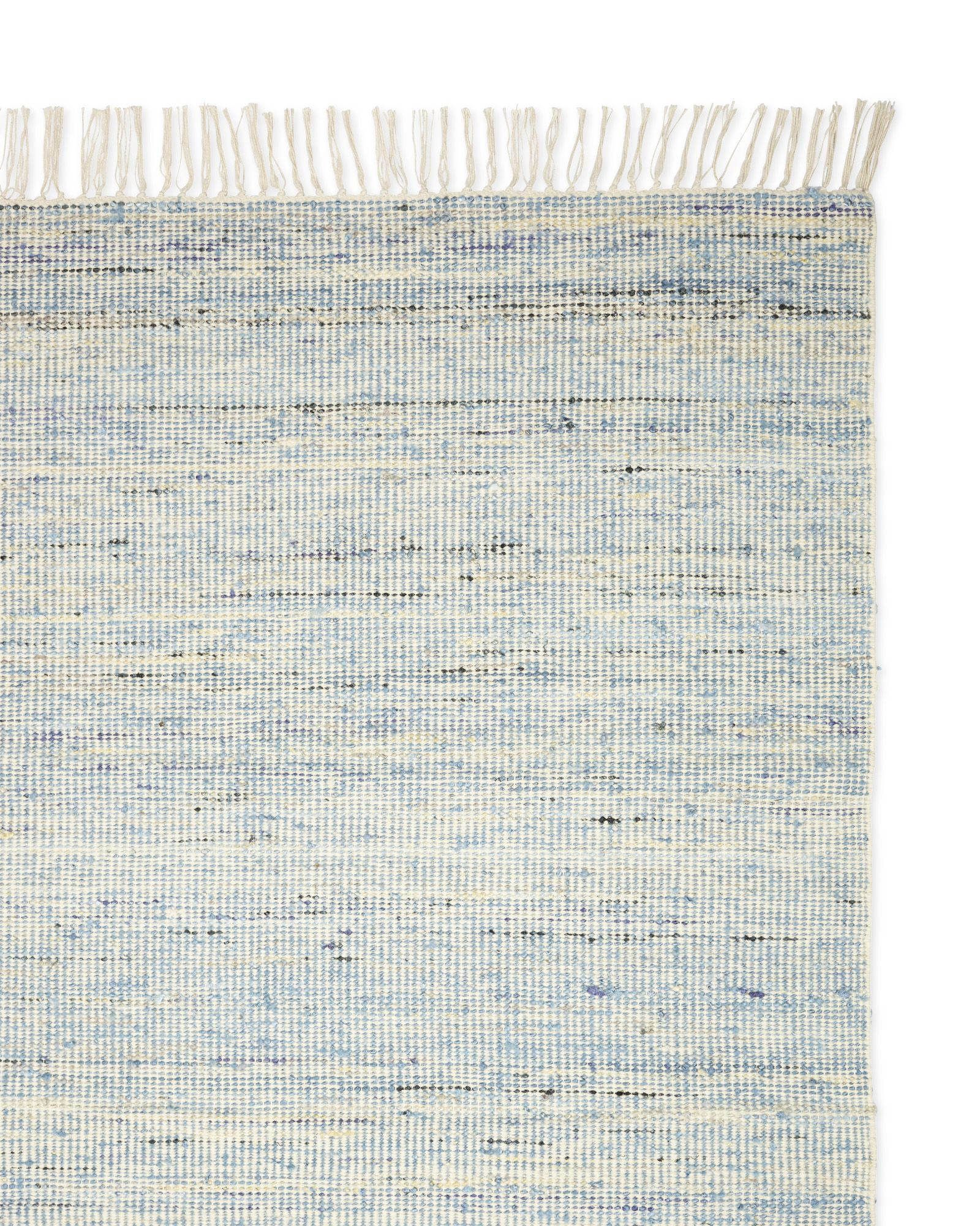A genuine one-of-a-kind rug, thanks to an ingenious mix of repurposed saris and plush wool, combined into yarns and woven by hand. We're smitten by the nuances in color and pattern – always interesting, but never too much.