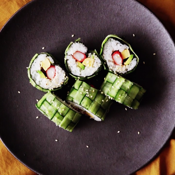 Cucumber Sushi Roll This beautiful sushi roll is easier to make than you'd think! A dish that's sure to impress your guest at your next gathering, they won't believe you made it yourself!This beautiful sushi roll is easier to make than you'd think! A dish that's sure to impress your guest at your next gathering, they won't believe you made it yourself!