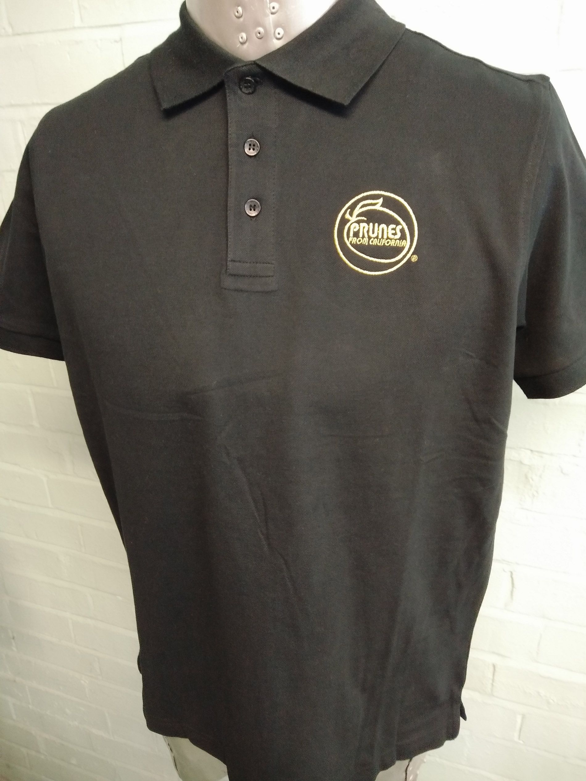 Black polo shirt event t shirts for prunes from california for Personalised embroidered polo shirts