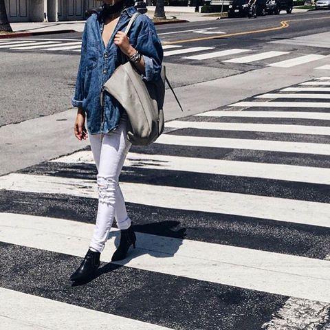 Denim on denim  @tania_sarin in @dstld white ripped skinny jeans