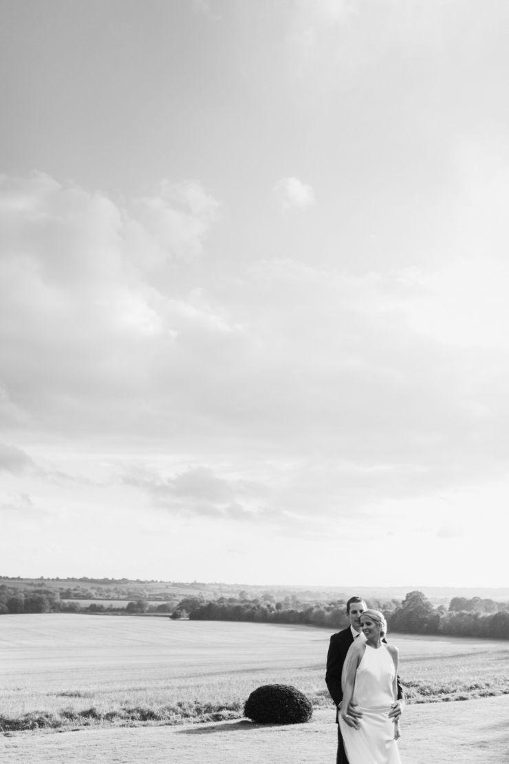 Intimate alternative wedding portrait in field - unusual wedding venues UK - artistic alternative Aynhoe Park wedding photography © Babb Photo