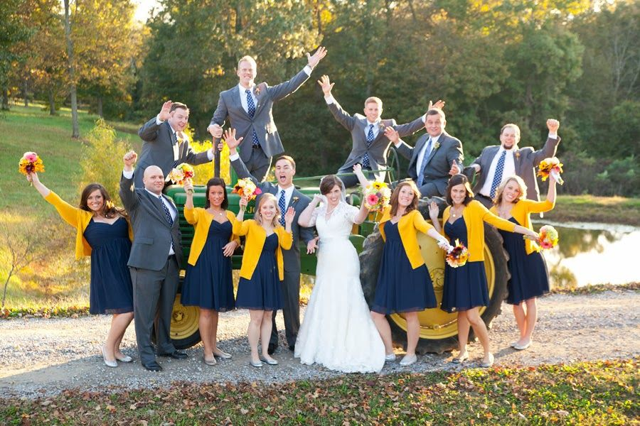Fun bridal party photo with the tractor! At an autumn wedding.  Photo by Krista Lee.  Shot at Owen Farm, Chapmansboro Tennessee