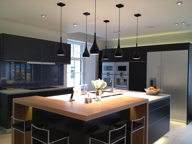Superbe Image Of Dark Kitchen With Large Square Island And Stainless Steel  Appliances