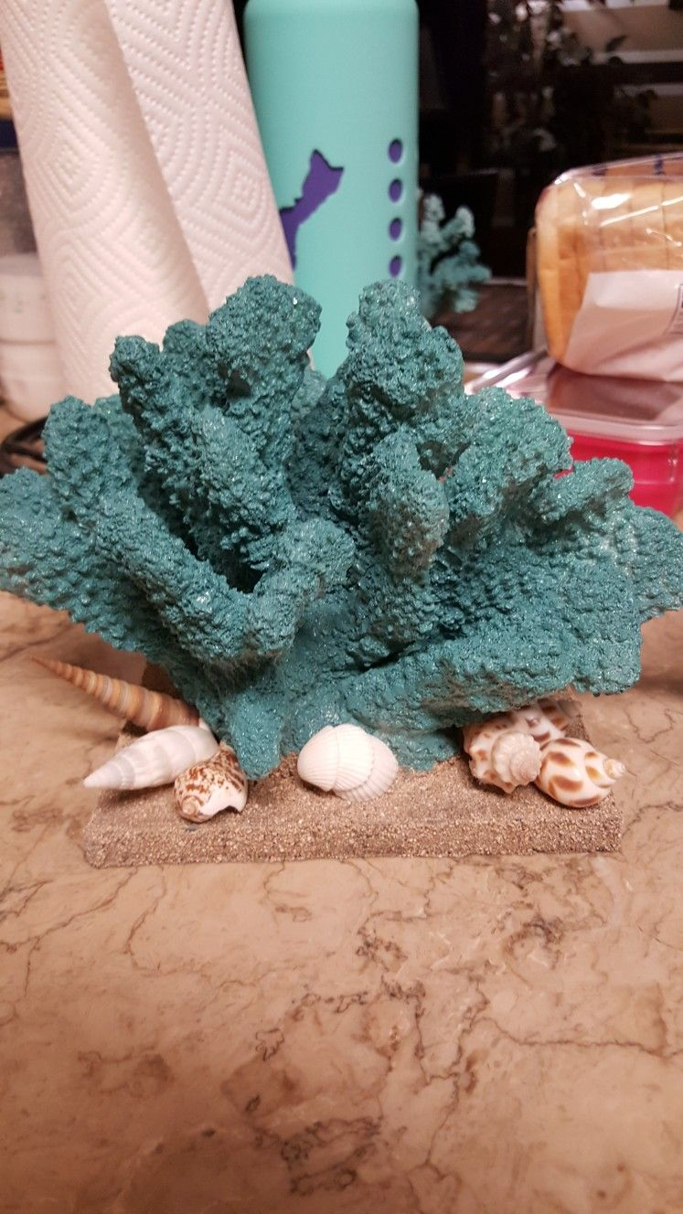 Knitted wedding decorations  Coral and seashell table decoration for a beach inspired wedding