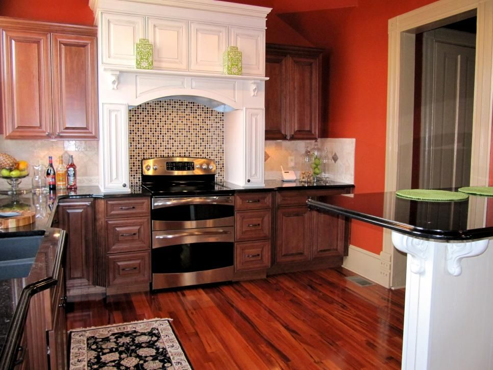 Dark Orange Kitchen Walls rustic brown cabinets paired with a bright white range hood and