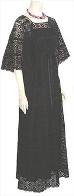 Mexican black cotton crochet maxi dress. Dress has a scoop neckline and a ribbon at the drawstring empire waist. The see through three quarter length bell sleeves are cut in one piece with the bodice. Hemline and sleeves are scalloped. Dress is lined in a black acetate and slips overhead. $125