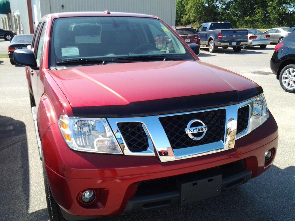 2013 Nissan Frontier in Red at Cedar Rapids Nissan Dealer