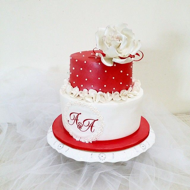 A red and white themed wedding cake