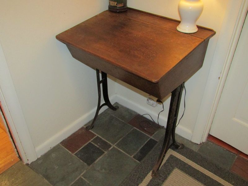 antique school desk, pay telephone, vintage and reproduction advertisements, golf collages