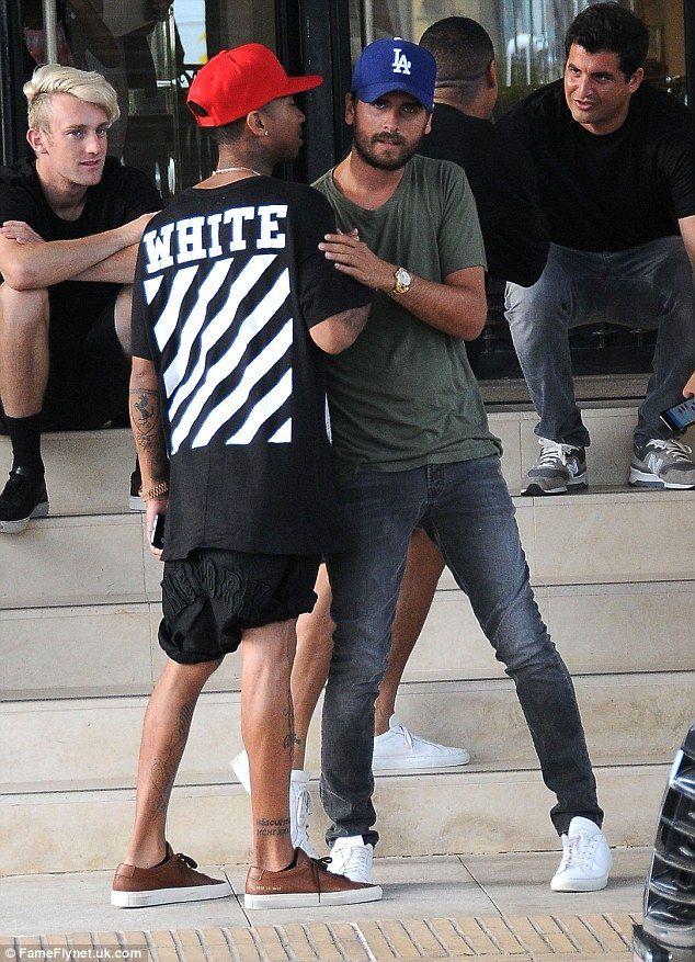 Kylie Jenner's beau Tyga runs into Kourtney's ex Scott