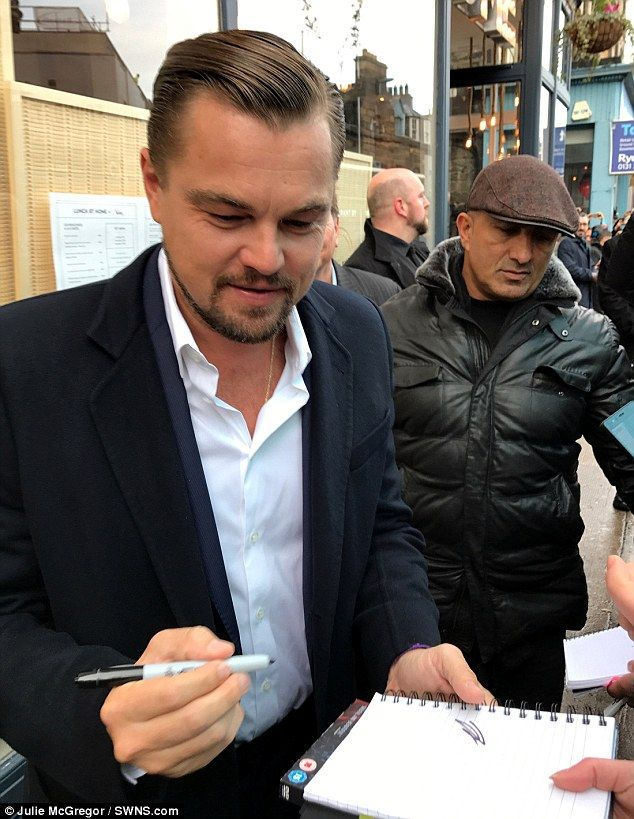 Scribble or signature? Leonardo DiCaprio produced a rather illegible autograph on Thursday...