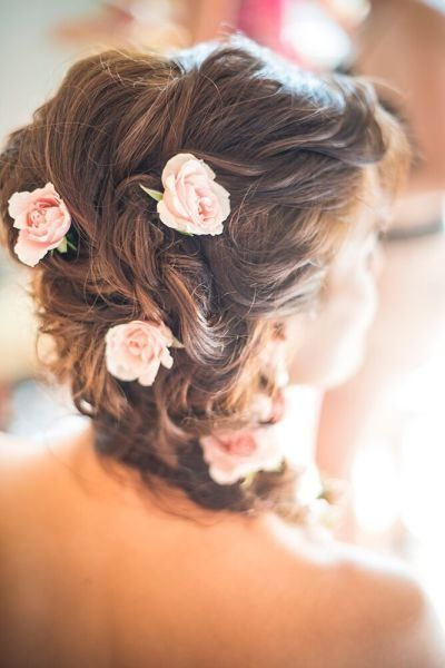 Our 16 Favorite Wedding Hairstyles With Flowers Braided Hairstyles For Wedding Flowers In Hair Romantic Wedding Hair
