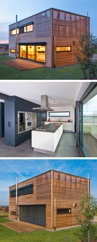 Holzhaus modern mit Flachdach & Holzfassade - Einfamilienhaus ...