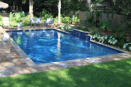 This Rectangle Swimming Pool With Water Features Located In Molasses Creek  Of Mt. Pleasant, SC Is Built By Aqua Blue Pools.