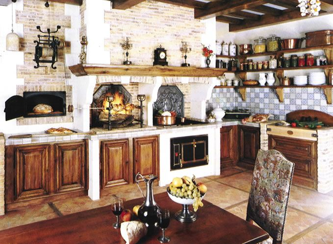 i really like the natural wood and brick colors in this kitchen