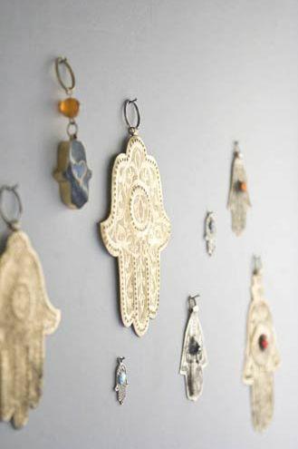 Wand vol handjes van Fatima.