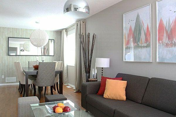 Schöner Wohnung schöner wohnen farben dunkles sofa mit einem orangen dekokissen und