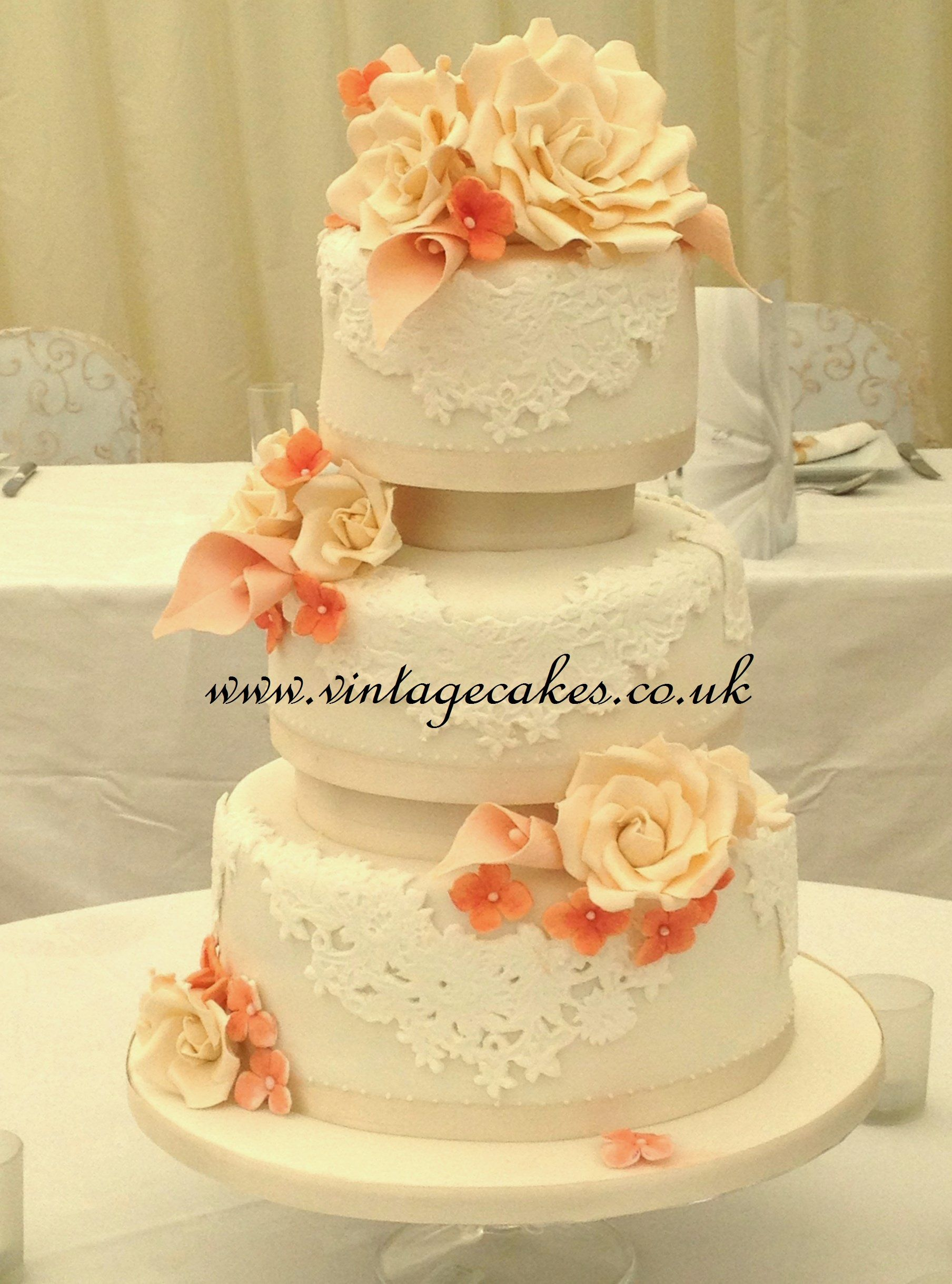 Peach and Coral Lace Cake - A 3 tier cake with separators, covered ...