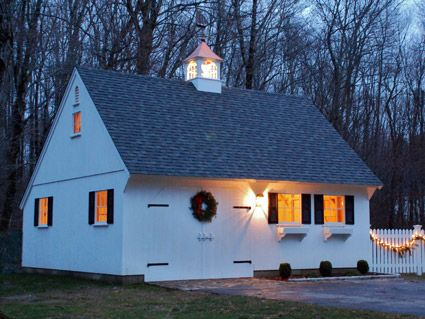 What a neat garage/guest house! Must have lighted cupola! Warm ...