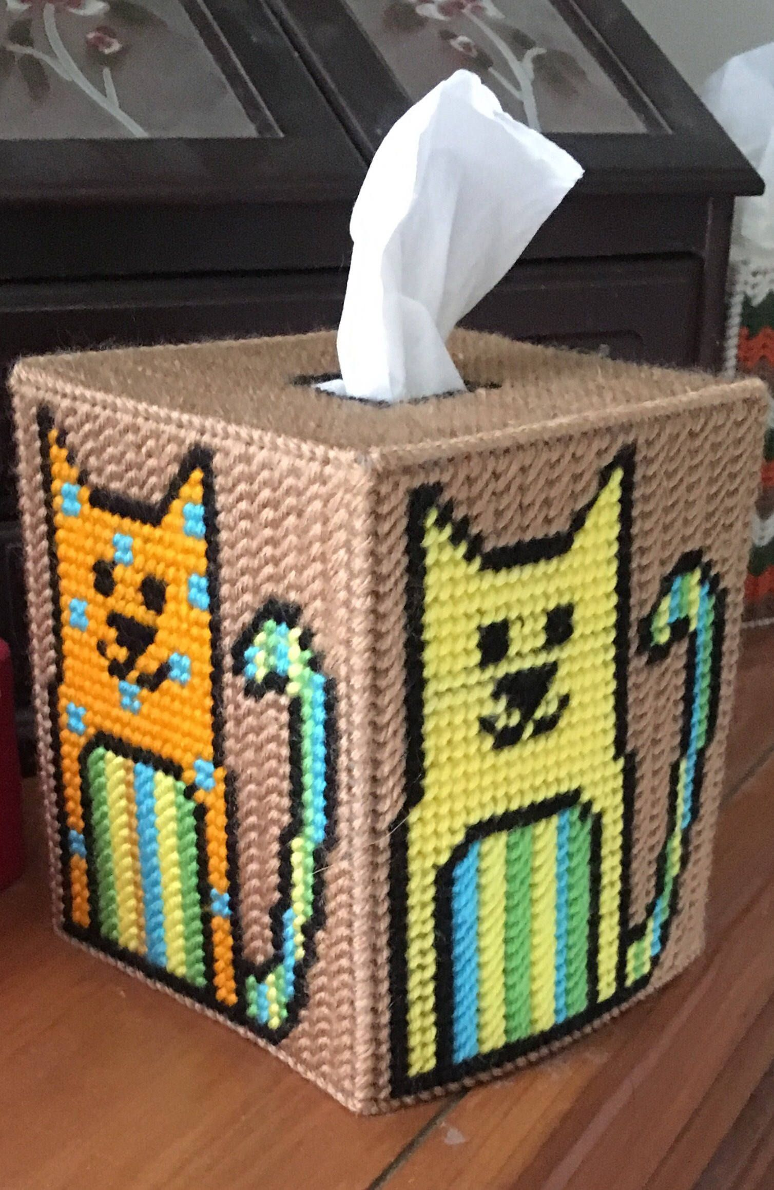 This Tissue Box Cover With Colorful, With Four Different Cats. Warm Brown  Background.