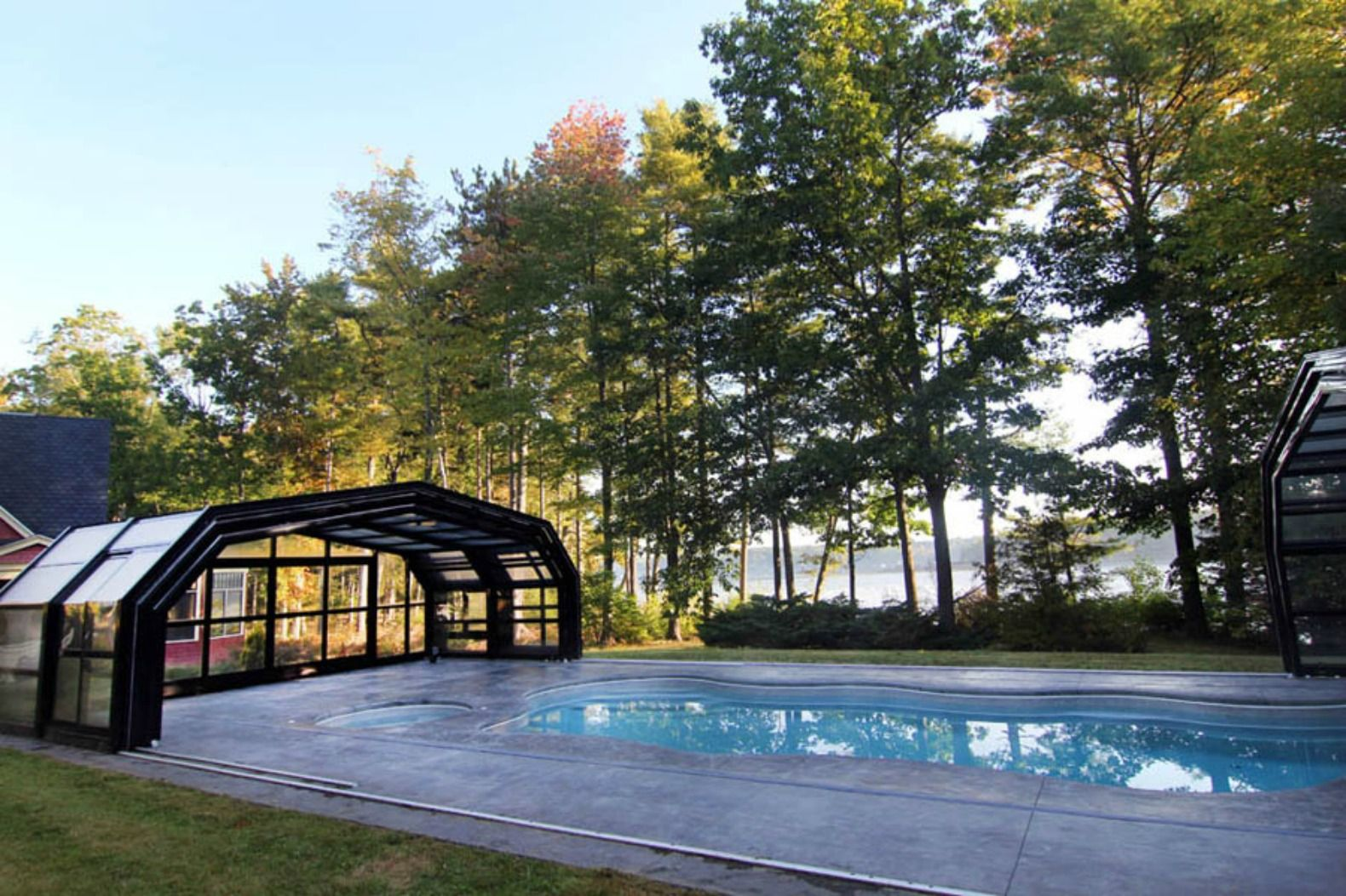 This Amazing Retractable Roof Shelters A Pool In Maine For Year Round Fun Pool Enclosures Pool Swimming Pool Enclosures