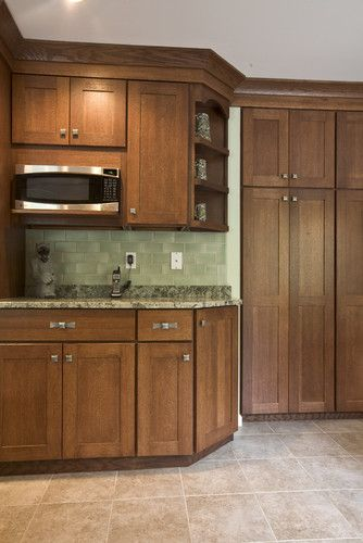 Chestnut Cabinets With Light Colored Tile Floors Definitely A Different Backsplash Though Chestnut Kitchen Cabinets Kitchen Design Kitchen Wall Colors