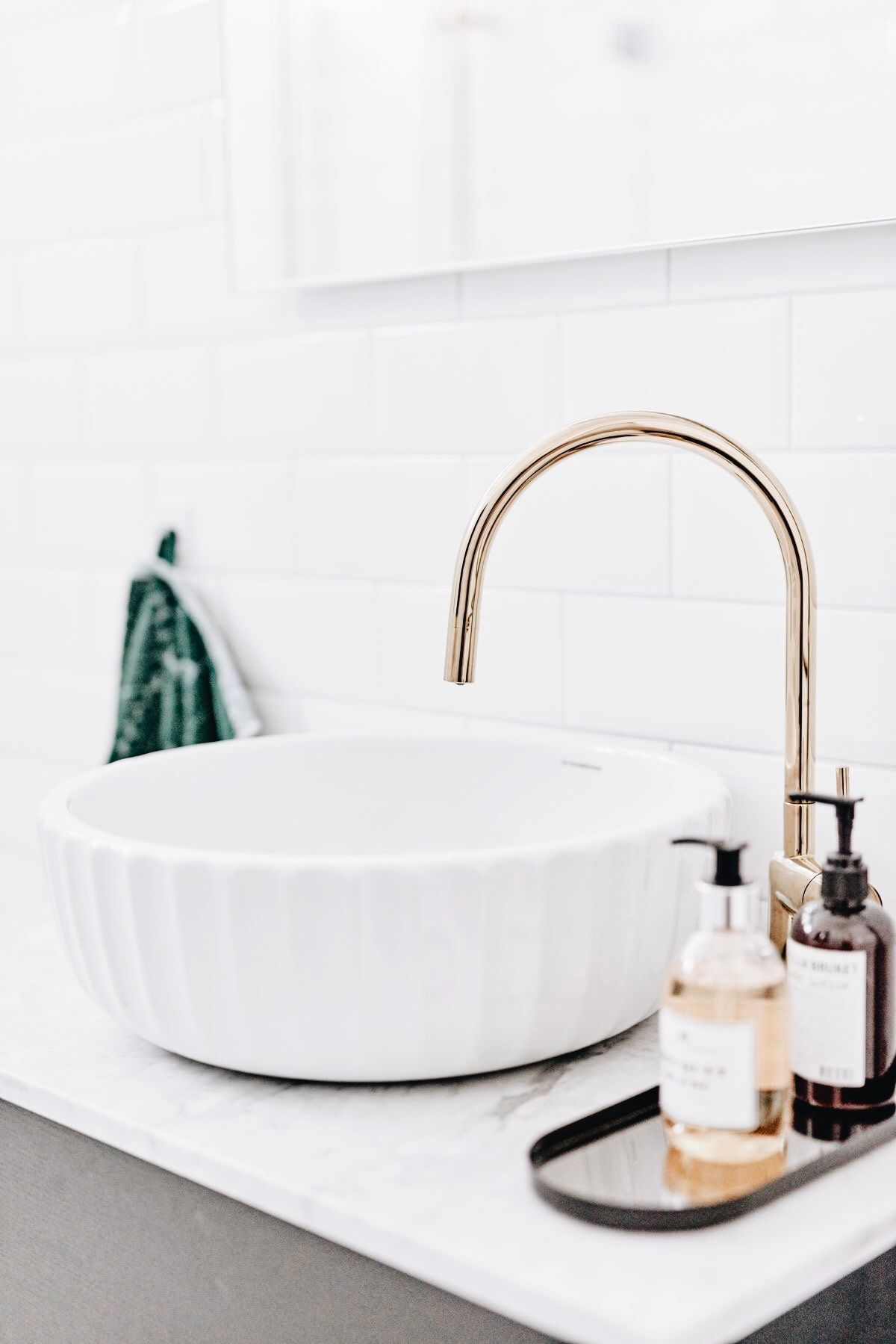 White bath sink with gold faucet white bath cabinet top and white