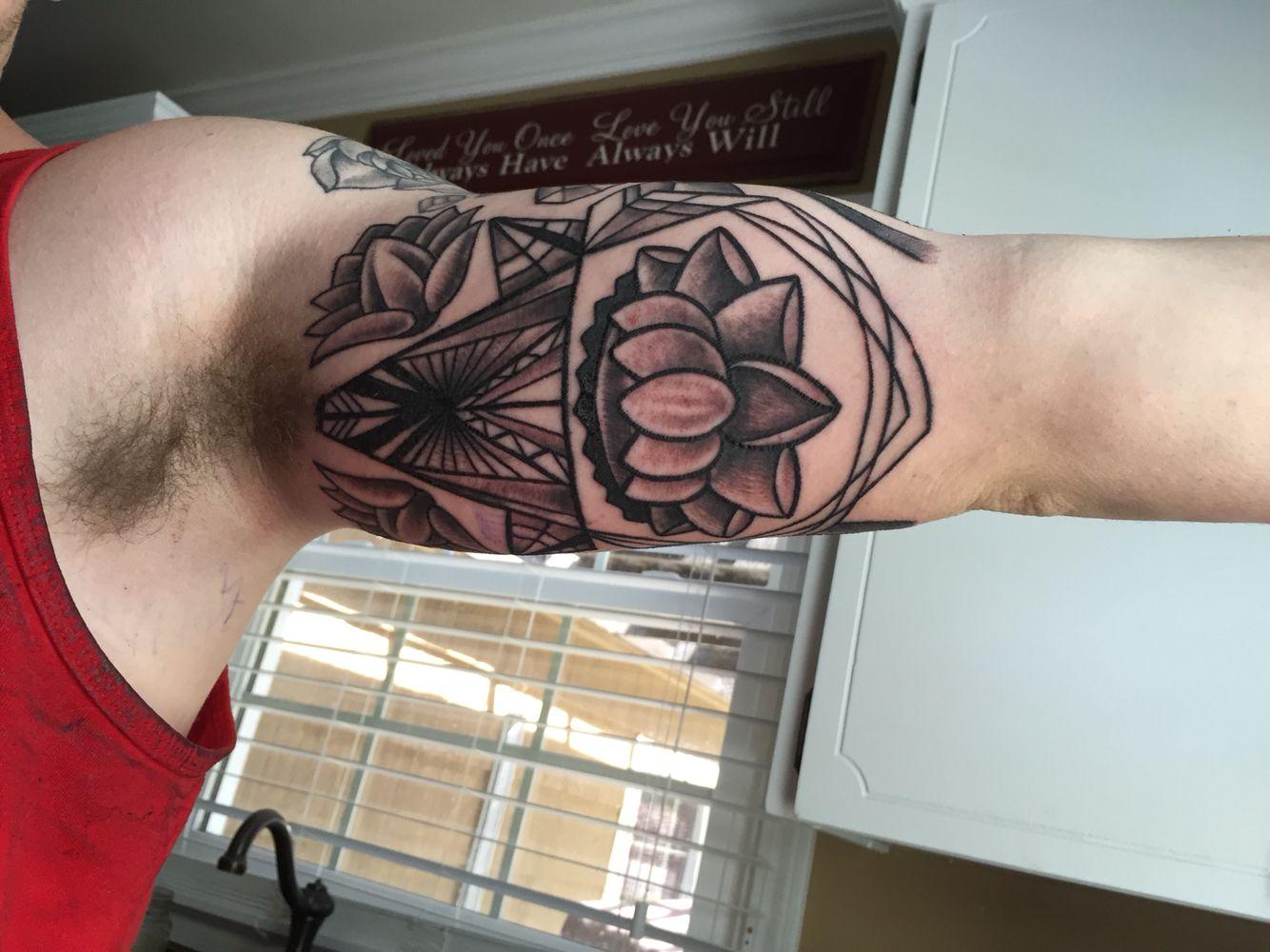 Geometric lotus half sleeve tattoo