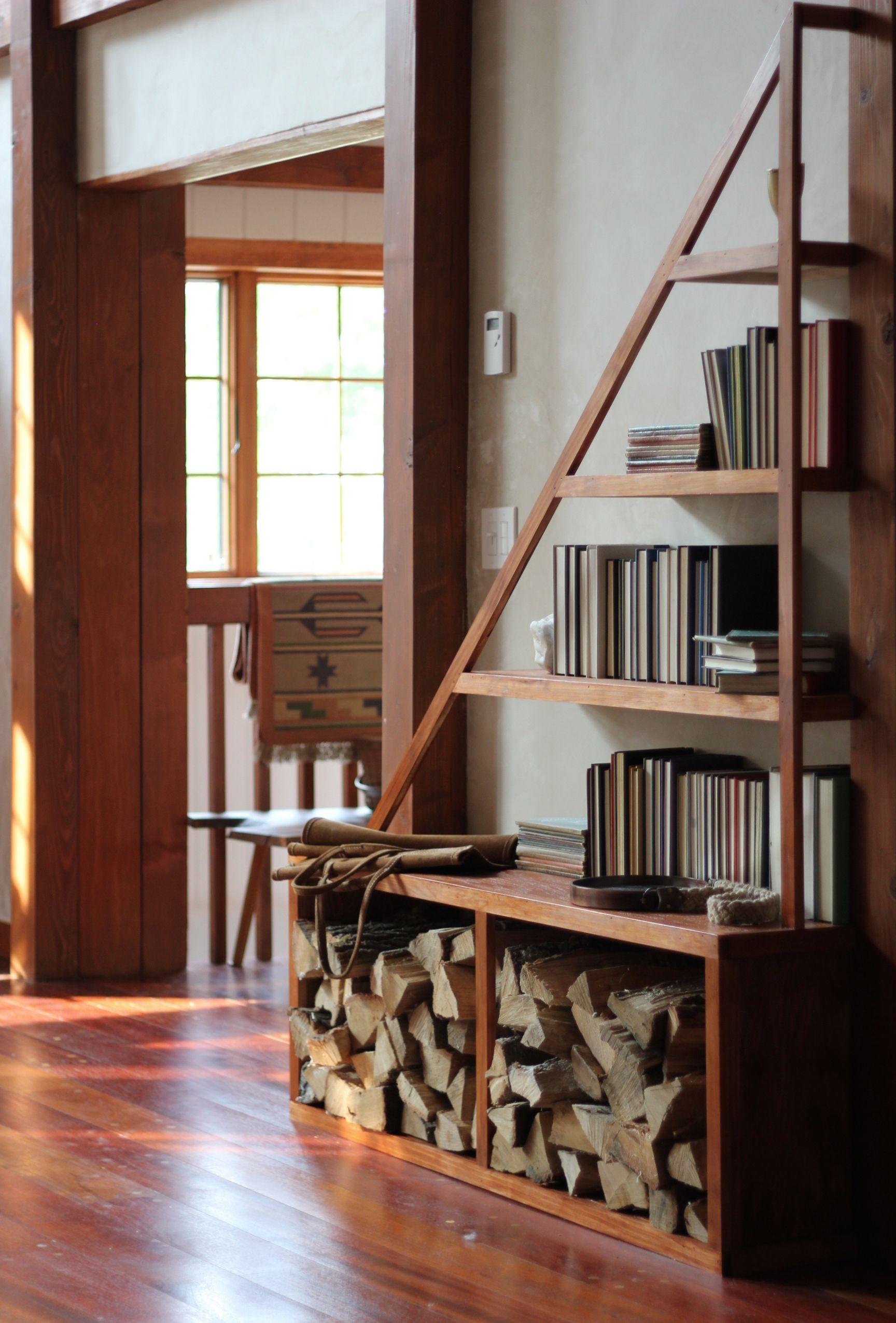 Captivating A Custom Triangular Bookshelf Sits Atop Built In Fireplace Wood Storage.  Photo By Heidiu0027s