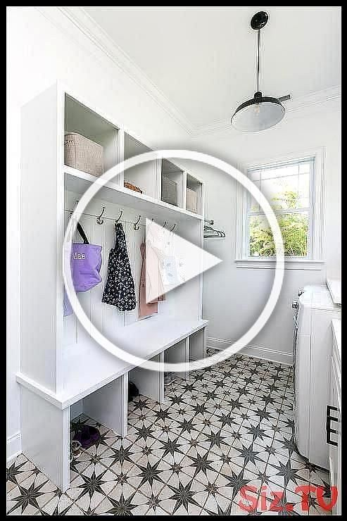 Laundry room and mudroom combo boasting gray starburst cement tiles and open mudroom lockers with hooks facing white front load washer and dryer set  Laundry room and mudroom combo boasting gray starburst cement tiles and open mudroom lockers with hooks facing white front load washer and dryer set Laundry Room Save Images Laundry Room Laundry room and mudroom combo boasting gray starburst cement tiles and open mudroo #boasting #cement #combo #dryer #facing #front #graylaundryroom #hooks #laundry #graylaundryrooms