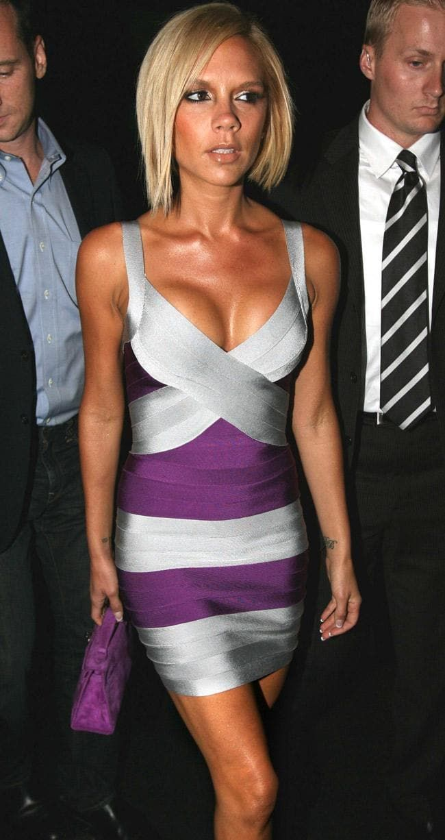 Attending a Marc Jacobs show in 2008, wearing a bandage dress by Hervé Léger