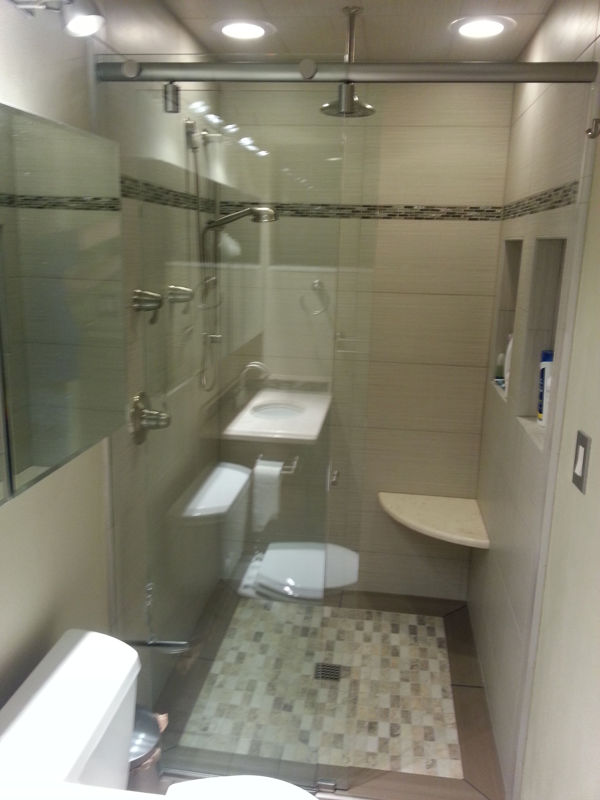 Small bathroom with inset tile floor, curbless shower, frameless ...