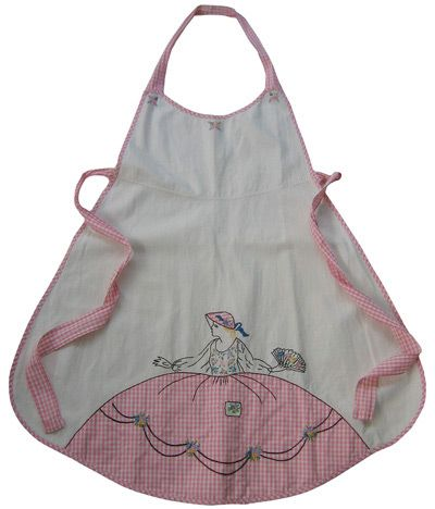 Embroidered lady in a bonnet... apron... in pink checked fabric...