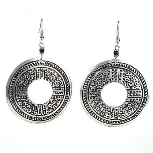 Stamped Recycled Cooking Pot 'Open Medallion' Earrings Handmade and Fair Trade. Handmade in Kenya, these earrings are hand-stamped and cut from aluminum that has been recycled from cooking pots. The earrings are 2 inches in diameter and hang from hypoallergenic hooks.