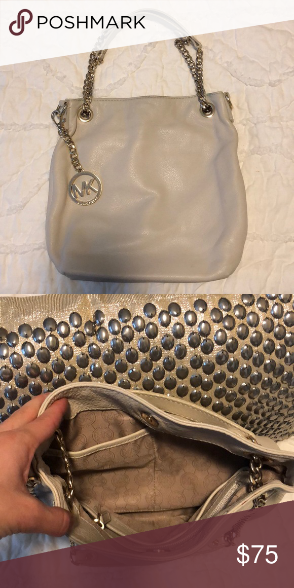 9c73e3c4f149 Michael Kors Purse White cream Michael Kors with gold chain accents on  straps. Gently used
