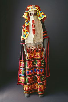 The Bani Sa'd tribe: Costumes - Mansoojat Foundation - Rashaidah thobe with patchwork decoration on the front, back and the right sleeve. The long burqu' (face mask) is embroidered with silver thread and has a fringe.