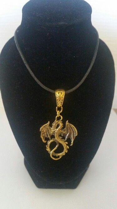 Antique gold dragon on cord. AUS $ 9.00