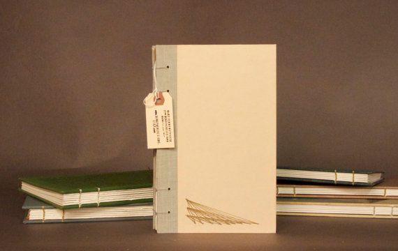 Gold Lines on Cream Coptic Bound Notebook Sketchbook Journal Scrapbook. $20.00, via Etsy.