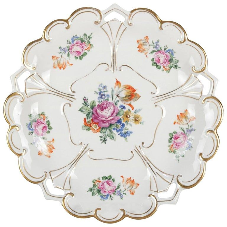 An antique German hand enameled porcelain charger by Henneberg-Porzellan features stylized flower form with floral reserves and gilt highlighting throughout, en verso maker stamp and numbered, circa 1920. ***DELIVERY NOTICE – Due to COVID-19 we are employing NO-CONTACT PRACTICES in the transfer of purchased items. Additionally, for those who prefer to delay shipping/delivery, we are offering FREE STORAGE of items until this crisis resolves. Measures: 1.5